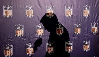 The shadow of NFL Commissioner Roger Goodell is cast on the NFL logo background as he pauses before answering a question from the media during a news conference at the annual NFL football meetings at the Arizona Biltmore, Wednesday, March 20, 2013, in Phoenix. (AP Photo/Ross D. Franklin)