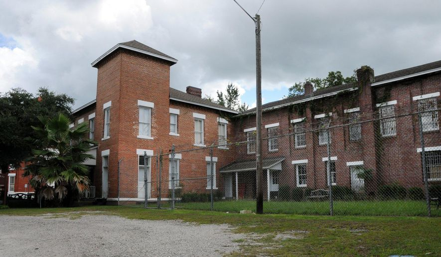 The historic Baker County jail is at 42 W McIver Avenue in Macclenny, Fla. (AP Photo/Forida Times-Union, Dede Smith)