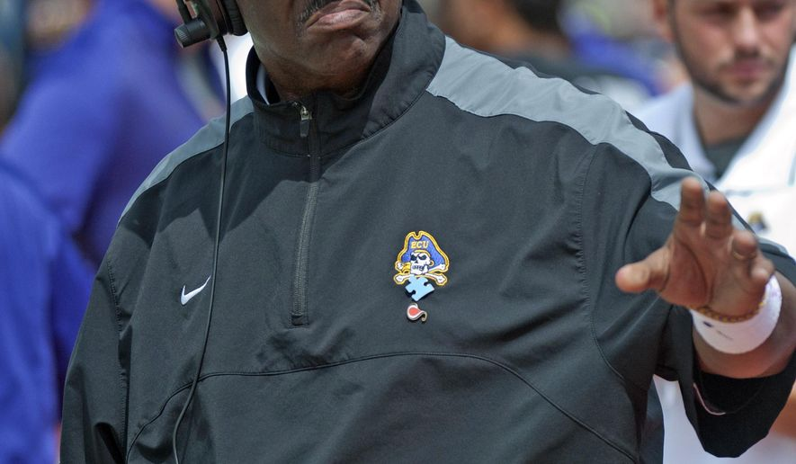 East Carolina head coach Ruffin McNeill looks on from the sideline during an NCAA college football game against Virginia Tech, Saturday, Sept. 13, 2014, in Blacksburg, Va. East Carolina won 28-21. (AP Photo/Don Petersen)