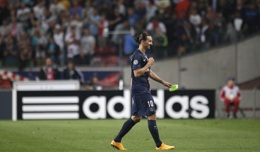 PSG's Zlatan Ibrahimovic leaves the pitch after the Group F Champions League match between Ajax and Paris Saint-Germain at ArenA stadium in Amsterdam, Netherlands, Wednesday, Sept. 17, 2014. The match ended in a 1-1 draw. (AP Photo/Peter Dejong)