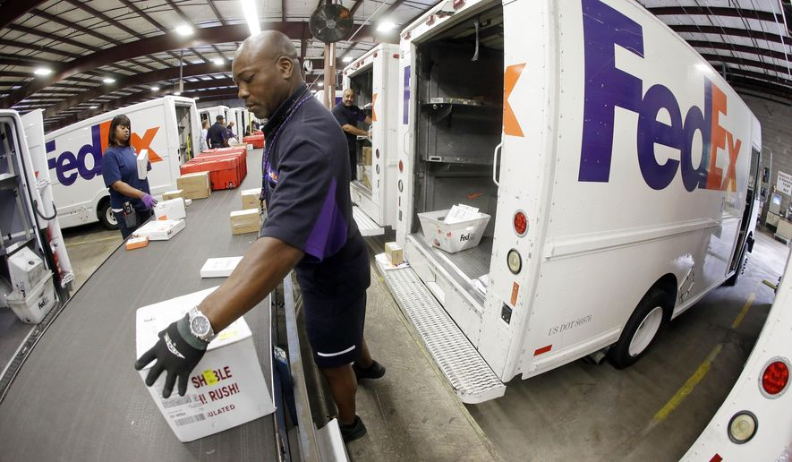 Mitchell Rodgers Loads Packages Into His Delivery Truck At The FedEx  Express Station In Nashville,  Fedex Jobs