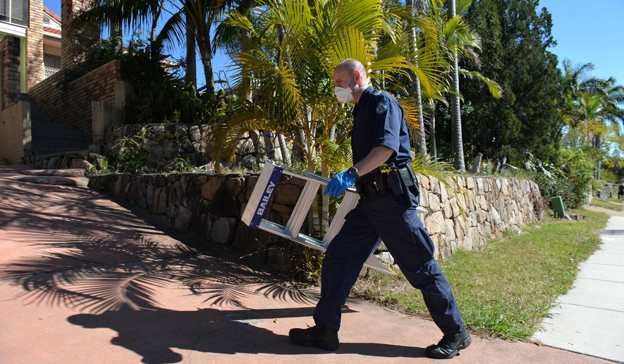 A police officer searches a house in Mount Gravatt, Brisbane, Australia, Thursday, Sept. 18, 2014. Australian police detained 15 people on Thursday in a major counterterrorism  operation, saying intelligence indicated a random, violent attack was being planned on Australian soil. (AP Photo/AAP Image, Dave Hunt)  AUSTRALIA OUT, NEW ZEALAND OUT, PAPUA NEW GUINEA OUT, SOUTH PACIFIC OUT, NO SALES, NO ARCHIVES