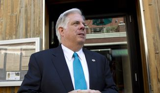 Maryland Republican gubernatorial candidate Larry Hogan speaks with reporters as he arrives at a fundraiser event, with New Jersey Gov. Chris Christie, at Bethesda, Md., on Wednesday, Sept. 17, 2014. Christie is chairman of the Republican Governors Association and came to Maryland in support for Republican gubernatorial candidate Larry Hogan. (AP Photo/Jose Luis Magana)