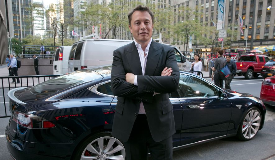 "SpaceX billionaire founder and chief executive, and Tesla Motors CEO Elon Musk, poses beside a Tesla, after his interview on ""Countdown to the Closing Bell,""  on the Fox Business Network, in New York,  Wednesday, Sept. 17, 2014. On Tuesday, NASA picked Boeing and SpaceX to transport astronauts to the International Space Station in the next few years.(AP Photo/Richard Drew)"