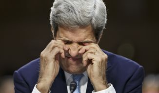 Secretary of State John Kerry rubs his eyes on Capitol Hill in Washington, Wednesday, Sept. 17, 2014, during a Senate Foreign Relations Committee hearing on the US strategy to defeat the Islamic State group. (AP Photo/J. Scott Applewhite)