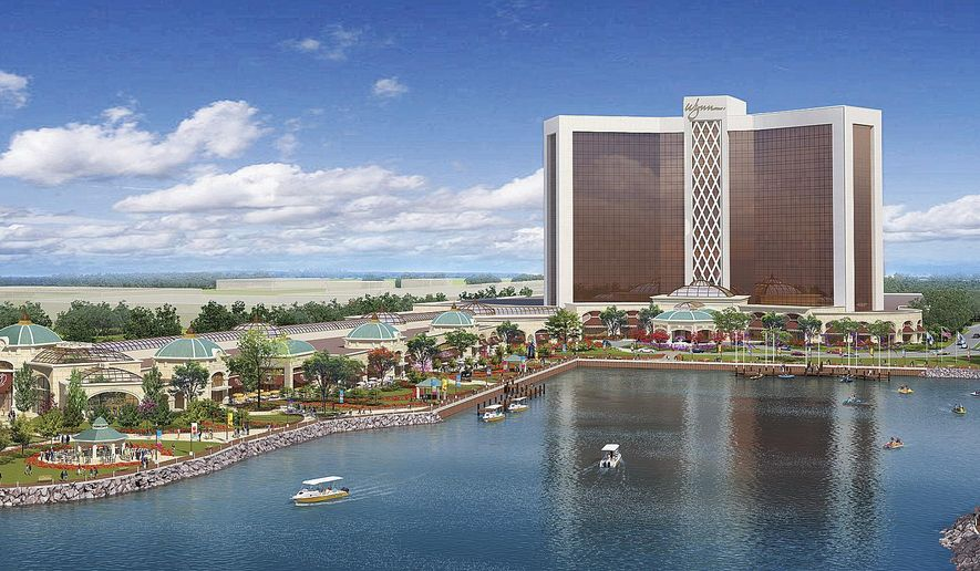 FILE - This file artist's rendering released March 27, 2013 by Wynn Resorts shows a proposed resort casino on the banks of the Mystic River in Everett, Mass. The Massachusetts Gaming Commission voted 3-to-1 Tuesday, Sept. 16, 2014, to award the license to the Las Vegas casino giant complex on land at the site of a former chemical plant. The decision came after Wynn conceded to a number of significant requests the commission made, including proposing alternative designs for its 27-story glass hotel tower.(AP Photo/Wynn Resorts, File)