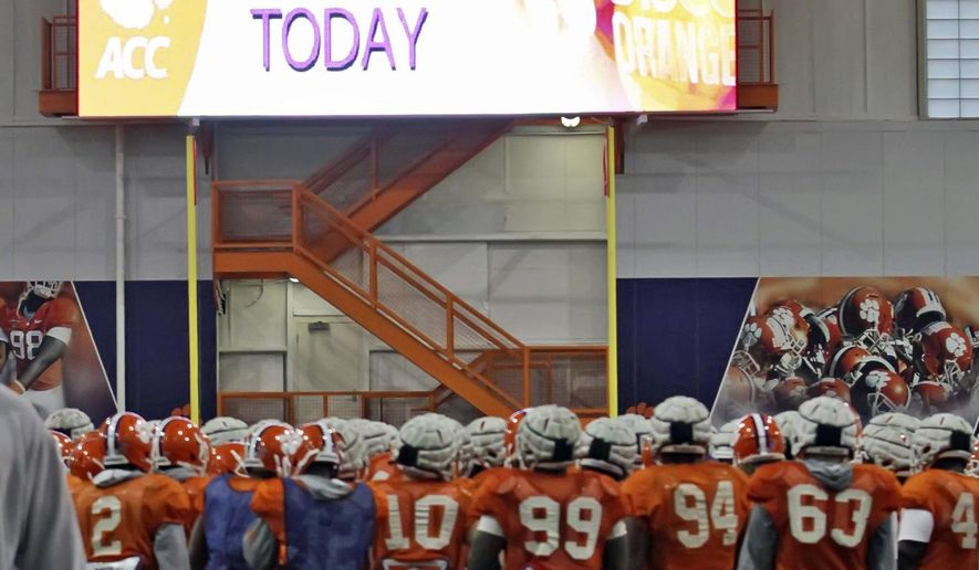 FILE - In this Dec. 14, 2013, file photo, Clemson players huddle before NCAA college football practice at their team's indoor facilityin Clemson, S.C. During the past 18 months, half the Atlantic Coast Conference  schools have either begun or completed major projects to upgrade their football facilities.  Clemson opened the new indoor practice facilities in 2013.(AP Photo/Anderson Independent-Mail, Mark Crammer, File) THE GREENVILLE NEWS OUT, SENECA NEWS OUT