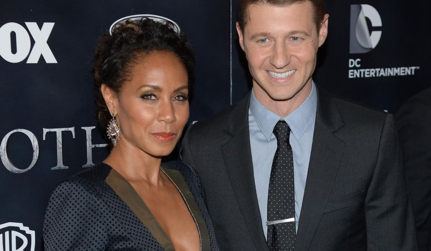 """Jada Pinkett Smith and Ben McKenzie arrive at """"Gotham"""" series premiere event at the New York Library on Monday, Sept. 15, 2014 in New York. (Photo by Evan Agostiniti/Invision/AP)"""