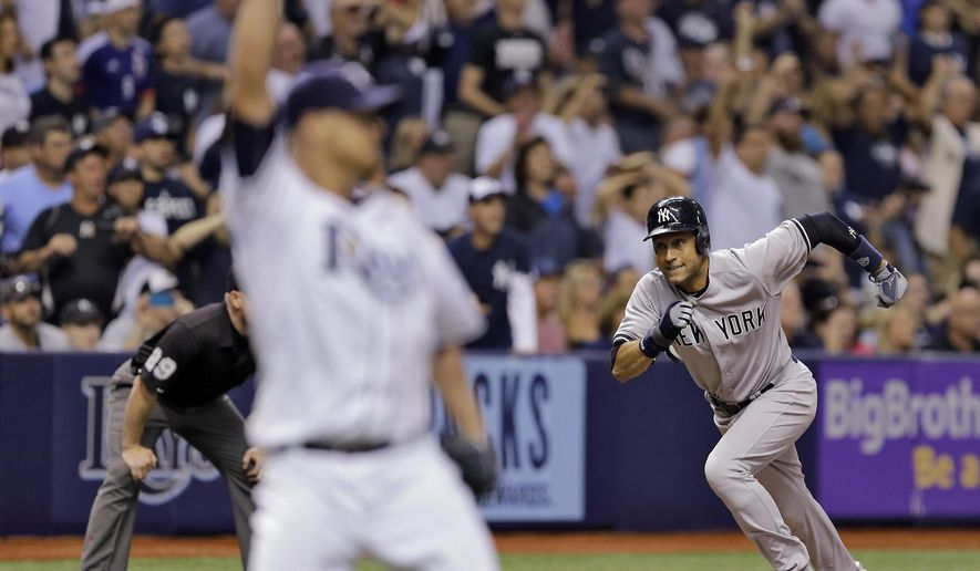 New York Yankees' Derek Jeter tags up from third base and scores on a sacrifice fly by Brett Gardner off Tampa Bay Rays starting pitcher Alex Cobb during the sixth inning of a baseball game Wednesday, Sept. 17, 2014, in St. Petersburg, Fla. (AP Photo/Chris O'Meara)