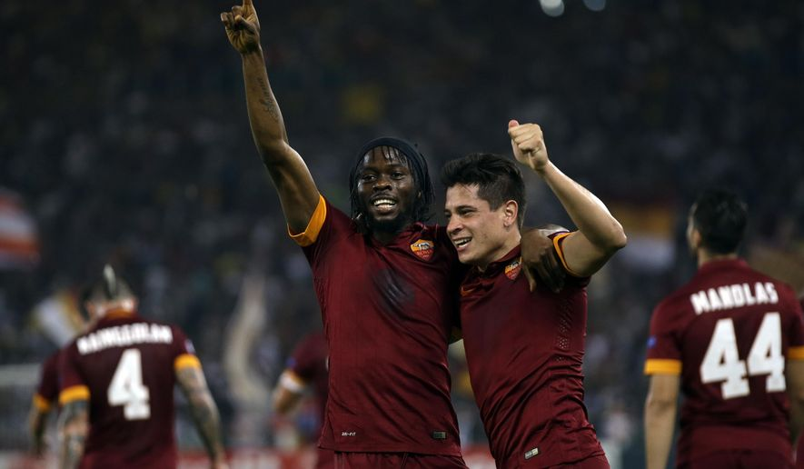 Roma's Gervinho, left, celebrates with his teammate Juan Manuel Arevalos Iturbe after scoring his side's second goal during a Champions League, Group E soccer match between Roma and CSKA, at the Olympic stadium, in Rome, Wednesday, Sept. 17, 2014. (AP Photo/Alessandra Tarantino)