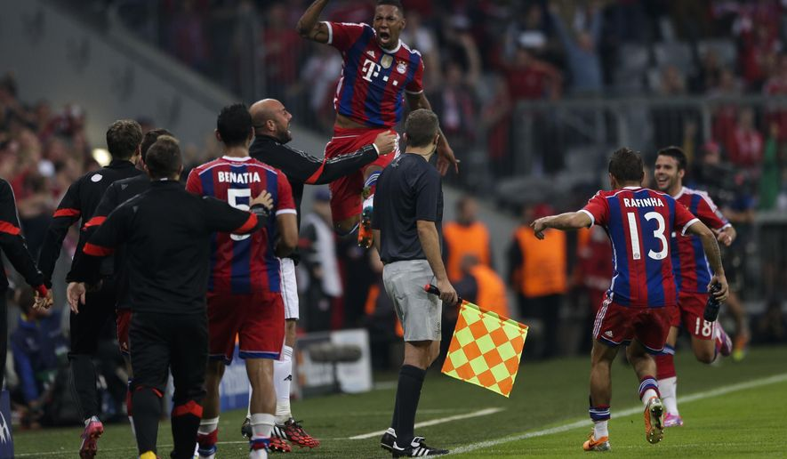 Bayern's Jerome Boateng, center, celebrates after he scored his side first goal during the Champions League Group E soccer match between FC Bayern Munich and Manchester City at Allianz Arena in Munich, southern Germany, Wednesday Sept. 17, 2014. (AP Photo/Matthias Schrader)