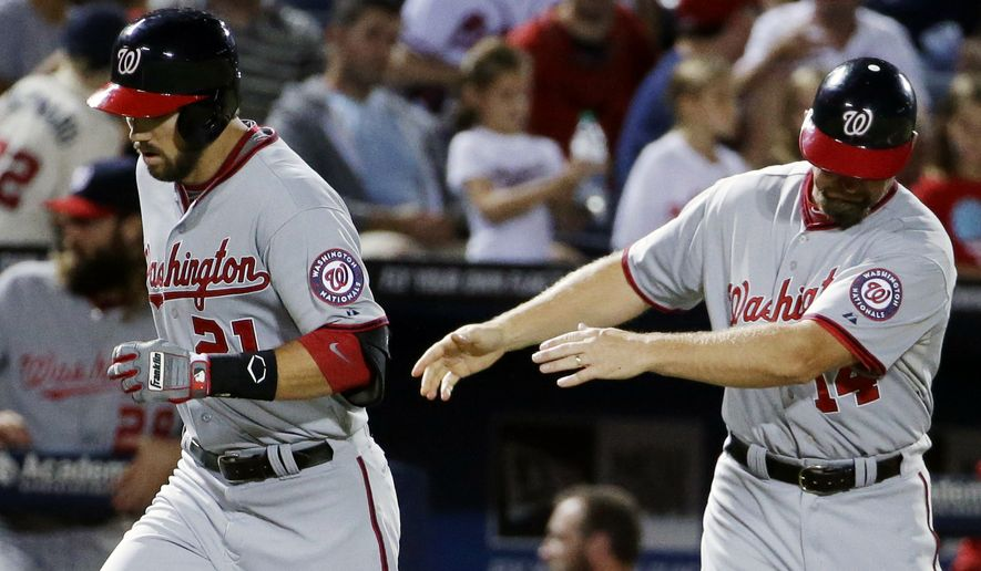 Washington Nationals' Steven Souza, left, runs past third base coach Bob Henley after shaking his hand after hitting a home run in the fifth inning of a baseball game against the Atlanta Braves, Wednesday, Sept. 17, 2014, in Atlanta. (AP Photo/David Goldman)