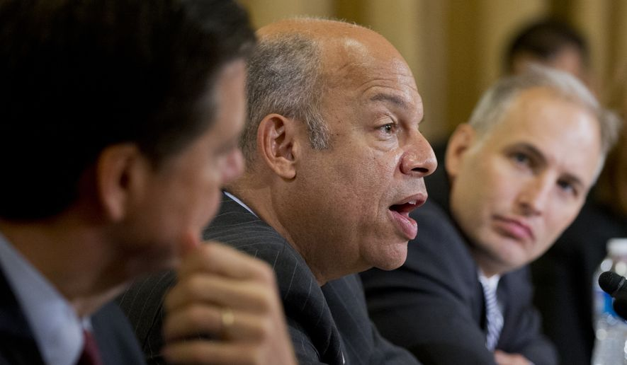 Federal Bureau of Investigation Director James Comey, from left, Department of Homeland Security Secretary Jeh Johnson, and National Counterterrorism Center Director Matthew Olsen testify before the House Homeland Security Full Committee during a hearing on Capitol Hill in Washington, Wednesday, Sept. 17, 2014.  (AP Photo/Manuel Balce Ceneta)