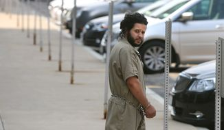 """Mufid Elfgeeh is taken from his arraignment in federal court  in Rochester, NY, Monday June 2, 2014.  The Rochester man was indicted Tuesday Sept. 16, 2014 on charges that he tried to provide material support to the Islamic State by helping three men who said they would travel to Syria to """"engage in violent jihad"""" alongside the group's militants, according to the Justice Department.  (AP Photo/Democrat & Chronicle, Shawn Dowd)"""