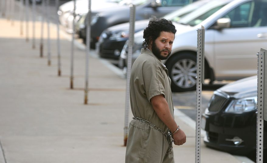 "Mufid Elfgeeh is taken from his arraignment in federal court  in Rochester, NY, Monday June 2, 2014.  The Rochester man was indicted Tuesday Sept. 16, 2014 on charges that he tried to provide material support to the Islamic State by helping three men who said they would travel to Syria to ""engage in violent jihad"" alongside the group's militants, according to the Justice Department.  (AP Photo/Democrat & Chronicle, Shawn Dowd)"