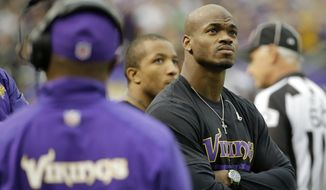 """Adrian Peterson, above, """"used the same kind of discipline with his child that he experienced as a child ... in East Texas,"""" said Rusty Hardin, the NFL star's lawyer in his Texas child abuse case. (AP Photo/Ann Heisenfelt, File)"""