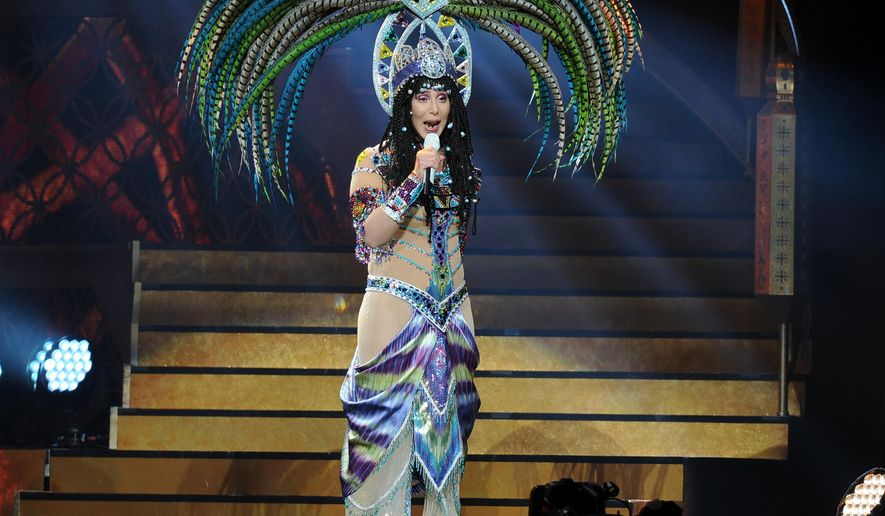 FILE - In this May 17, 2014 file photo, Cher performs during the D2K Tour 2014 at the BB&T Center in Sunrise, Fla. Three backup dancers have sued Cher claiming they were wrongfully fired from her current tour and the singer engaged in racial discrimination. The trio filed a wrongful termination lawsuit in Los Angeles Superior Court on Thursday, Sept. 18, 2014.   (Photo by Jeff Daly/Invision/AP, file)