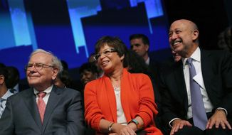 Warren Buffett, left, Valerie Jarrett, White House senior advisor, center, and Lloyd Blankfein, Goldman Sachs Chairman and CEO , look on during the Goldman Sachs celebration ceremony of the first graduating class of the 10,000 Small Businesses at Wayne State University on Thursday, Sept. 18, 2014, in Detroit. The investment banking firm committed $20 million to Detroit and southeast Michigan to help small businesses create jobs and economic growth by providing entrepreneurs with a practical business education, access to capital and business support services. (AP Photo/Detroit Free Press, Jessica J. Trevino)  DETROIT NEWS OUT;  NO SALES