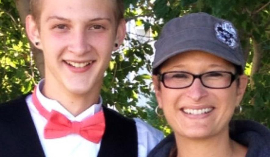 In this photo provided by Daniel J. Haus, attorney for the family, is Bryce Masters with his mother, Stacy Masters.  The FBI is investigating after a police officer in suburban Kansas City, Missouri, used a stun gun to subdue 17-year-old Bryce during a traffic stop Sunday, Sept. 14, 2014, leaving him hospitalized in critical condition. (AP Photo/family photo via Daniel Haus)