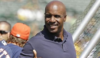 In this Sept. 6, 2014, photo, career home run leader Barry Bonds gives a thumbs up while standing behind the batting cage and watching the Houston Astros take batting practice before the start of their baseball game against the Oakland Athletics Saturday, Sept. 6, 2014, in Oakland, Calif. (Associated Press) **FILE**