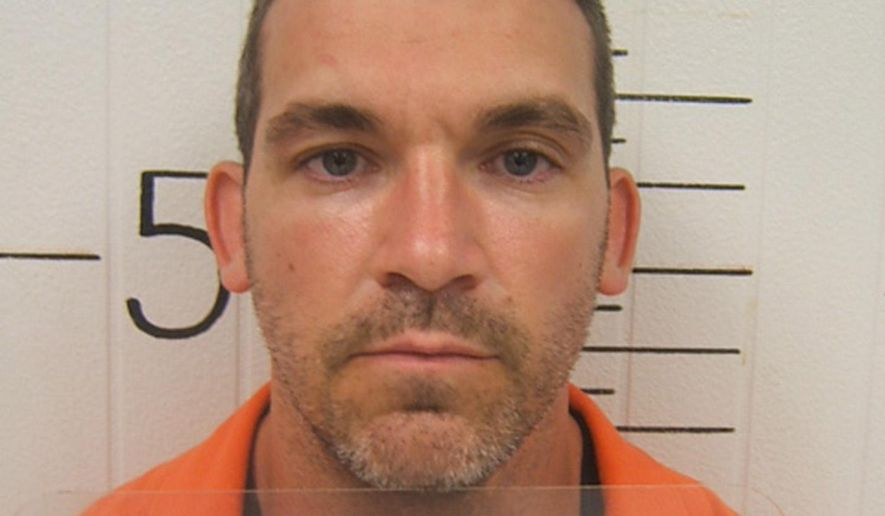 This undated photo provided by the Kentucky Department of Corrections on Thursday, Aug. 18, 2014 shows Patrick W. Darcy. On Thursday, the Kentucky Supreme Court overturned the burglary and fleeing convictions of the 37-year-old Darcy after concluding that a judge should have delayed the trial of Darcy and a co-defendant. The case pitted the rights of defendants being tried together to have the attorney of their choosing against the right to a quick court proceeding. (AP Photo/Kentucky Department of Corrections)