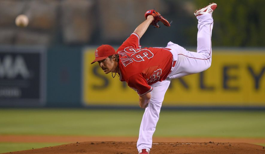 Los Angeles Angels starting pitcher C.J. Wilson throws to the plate during the first inning of a baseball game against the Seattle Mariners, Wednesday Sept. 17, 2014, in Anaheim, Calif. (AP Photo/Mark J. Terrill)