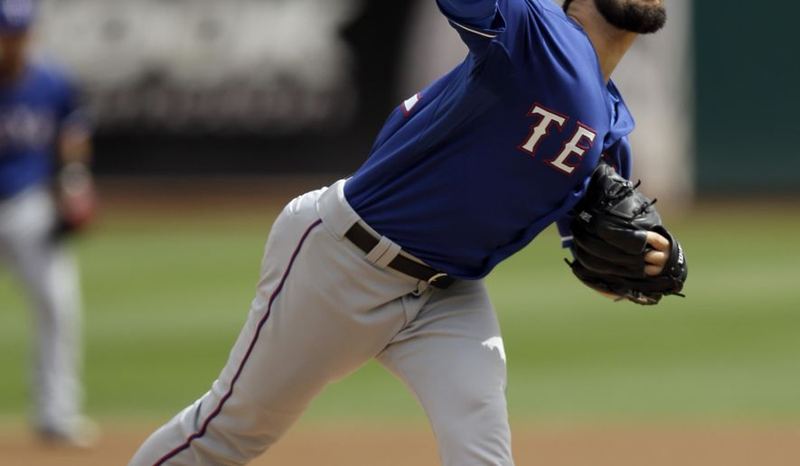 Texas Rangers' Nick Martinez works against the Oakland Athletics in the first inning of a baseball game Thursday, Sept. 18, 2014, in Oakland, Calif. (AP Photo/Ben Margot)