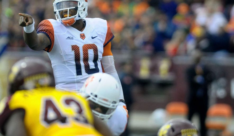Syracuse quarterback Terrel Hunt shouts at the line of scrimmage against Central Michigan  during an NCAA college football game in Mount Pleasant, Mich., Saturday, Sept. 13, 2014. Syracuse won 40-3.  (AP Photo/The Morning Sun, Lisa Yanick Jonaitis)