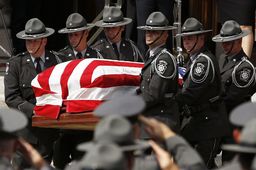 An honor guard carries the casket of Pennsylvania State Trooper Cpl. Bryon Dickson  from his funeral service, Thursday, Sept. 18, 2014, in Scranton, Pa. Dickson was killed on Friday night in an ambush shooting at the state police barracks in Blooming Grove Township. Authorities are looking for 31-year-old Eric Frein, of Canadensis, who has been charged with killing one trooper and wounding another outside the barracks. (AP Photo/Matt Slocum)