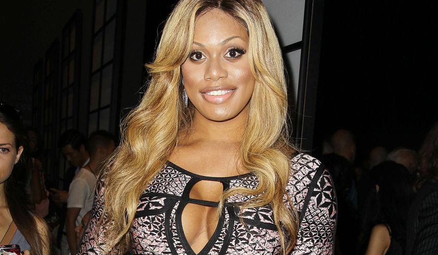 """In this Sept. 6, 2014 image released by Starpix, actress Laverne Cox poses at the Herve Leger by Max Azria Spring 2015 show during Fashion Week in New York. Cox will host a documentary on MTV and Logo next month that profiles seven young transgenders. The special, """"Laverne Cox Presents: The T Word,"""" will air simultaneously on the two channels on Oct. 17. Cox, a transgender actress, was nominated for an Emmy Award for her role in Netflix's """"Orange is the New Black."""" (AP Photo/Starpix, Amanda Schwab, File)"""