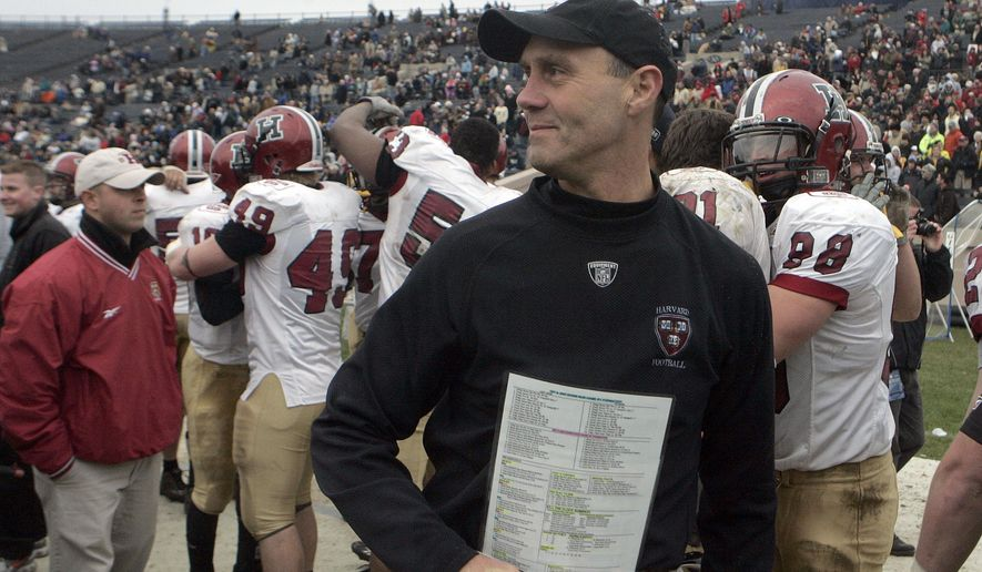 FILE - In this Nov. 17, 2007, file photo, Harvard football coach Tim Murphy smiles after his team defeated Yale 37-6 in an NCAA college football game to win the Ivy League title at the Yale Bowl in New Haven, Conn. With a hands-on approach, Murphy has built an Ivy League empire during two decades at Harvard and become the winningest coach in school history. (AP Photo/Bob Child, File)