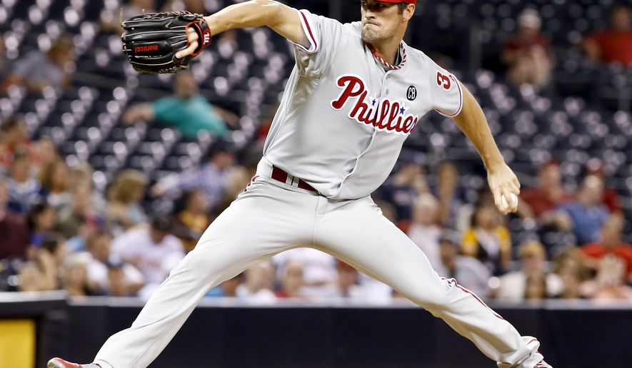 Philadelphia Phillies starting pitcher Cole Hamels throws against the San Diego Padres during the seventh inning of a baseball game Wednesday, Sept. 17, 2014, in San Diego. (AP Photo/Don Boomer)