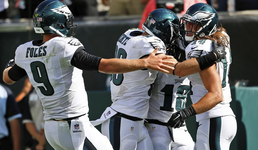 FILE - In this Sept. 7, 2014, file photo, Philadelphia Eagles players, from left, Nick Foles, Zach Ertz, Jeremy Maclin and Riley Cooper celebrate after a touchdown by Maclin during the second half of an NFL football game against the Jacksonville Jaguars in Philadelphia. he Associated Press awards a Comeback Player of the Year in February. Maybe this season the AP should hand out comeback team honors, too. The leaders after two weeks: the Eagles. (AP Photo/Michael Perez, File)