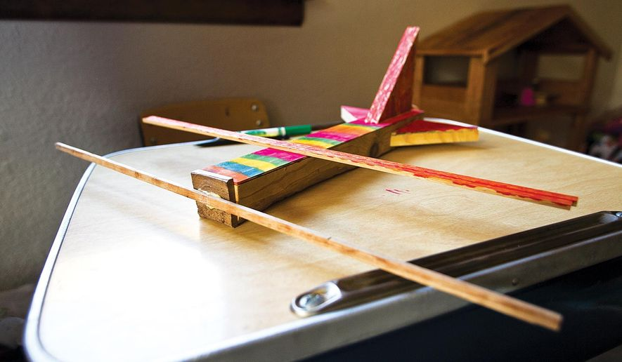 A Sept. 11, 2014 photo shows the first wooden model airplane built by James Vasek, 6, who came up with the idea to build the wooden planes, sell them and donate the proceeds to the Heart to Heart Walk for Life, an idea he hatched entirely himself.  (AP Photo/Laramie Daily Boomerang, Jeremy Martin)