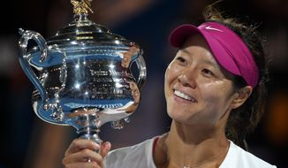 FILE - In this Jan. 25, 2014 file photo, Li Na of China holds the championship trophy after defeating Dominika Cibulkova of Slovakia in their women's singles final at the Australian Open tennis championship in Melbourne, Australia. Li, a two-time Grand Slam champion from China who took tennis in Asia to a new level, announced her retirement on Friday, Sept. 19, 2014. (AP Photo/Rick Rycroft, File)