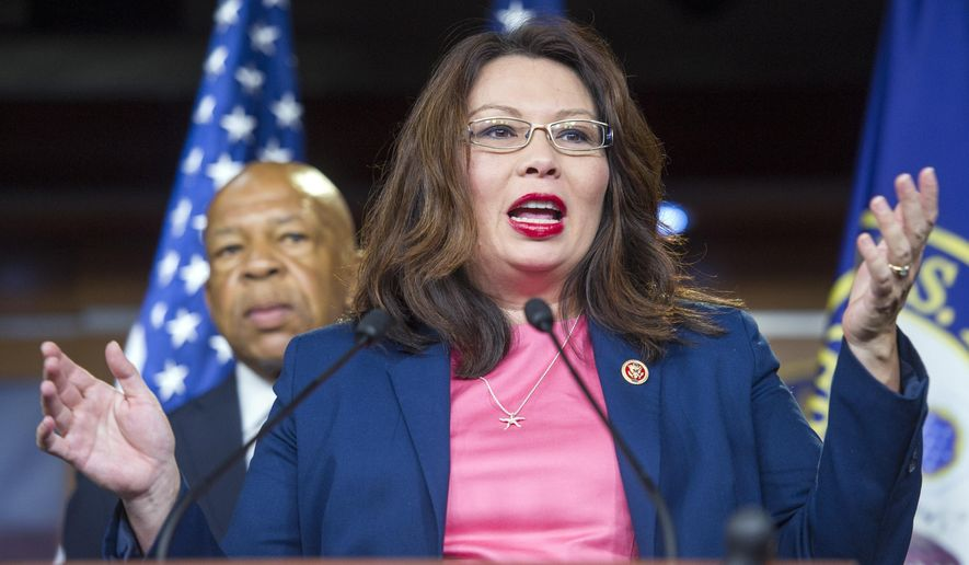In this Tuesday, Sept. 16, 2014 photo, Rep. Tammy Duckworth, D-Il., speaks with reporters about the the release of a website titled Benghazi on the Record, during a news conference on Capitol Hill in Washington.  House Select Committee on Benghazi Ranking Member Rep. Elijah Cummings, D- Md., is at the rear.   The effort to train and arm Syrian rebels is proving a tough sell with some Iraq and Afghanistan war veterans in Congress.  Wariness of the plan crossed party lines in a House vote on Wednesday. Republican and Democratic veterans alike say they fear weapons and training will one day be used against Americans instead of militants seeking an Islamic state. (AP Photo/Cliff Owen)