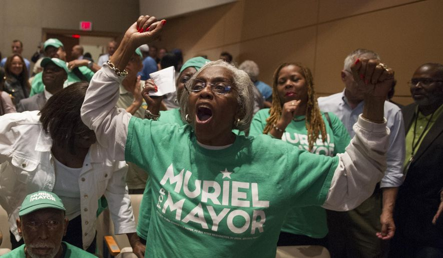Supporters of D.C. Councilmember Muriel Bowse, who defeated incumbent mayor Vincent Gray in the April Democratic primary, express themselves during the first three candidate D.C. Mayoral candidate debate at American University in Washington, Thursday, Sept. 18, 2014.  The election will take place on Nov. 4, 2014, to elect the Mayor of Washington, D.C. (AP Photo/Cliff Owen)