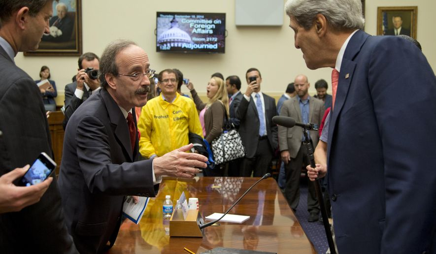 Secretary of State John Kerry, right, speaks with House Foreign Affairs Committee ranking member Rep. Eliot Engel, D-N.Y., on Capitol Hill in Washington, Thursday, Sept. 18, 2014, after a House Foreign Affairs Committee hearing. At the hearing, Kerry sought to push back on an argument by some in Congress that Syria's rebels lack moderates, or at least any with the capacity to make a difference in the war. (AP Photo/Carolyn Kaster)