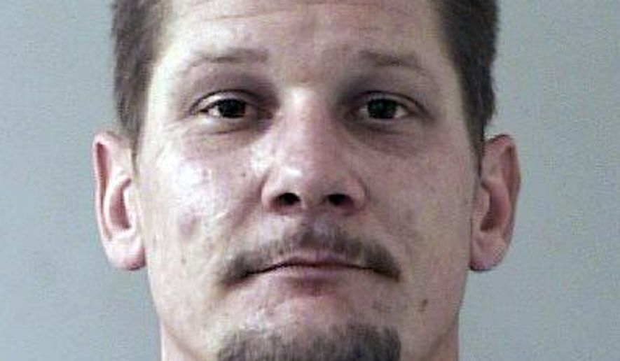 This image released by the El Dorado County Sheriff's department shows Wayne Allen Huntsman in his booking photo in Placerville, Calif.  Huntsman has been arrested on suspicion of arson in an out-of-control Northern California wildfire that has driven nearly 2,800 people from their homes as it continues to grow, authorities said Thursday, Sept. 18, 2014.  (AP Photo/El Dorado County Sheriffs)