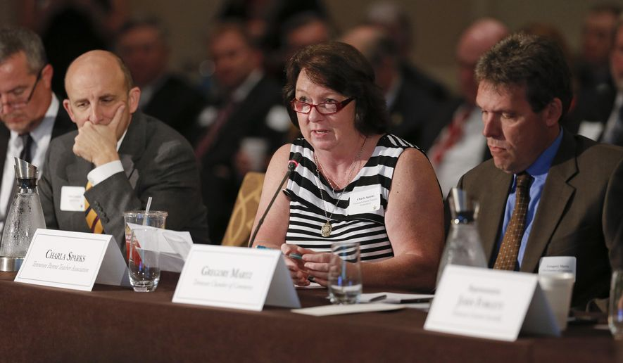 Charla Sparks, center, of the Tennessee Parent Teacher Association, speaks at Tennessee's Education Summit on Thursday, Sept. 18, 2014, in Nashville, Tenn. Representatives of local governments, school systems and businesses are taking part in the summit, along with state senators and representatives. (AP Photo/Mark Humphrey)