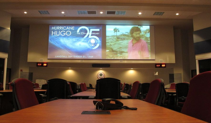 The command center at the South Carolina Emergency Management Division sits empty and is showing South Carolina ETV documentaries on Hurricane Hugo on Thursday, Sept. 18, 2014, in Pine Ridge, S.C. The state built the center in 2000 to better respond to disasters like Hugo, which struck the state in September1989. (AP Photo/Jeffrey Collins)