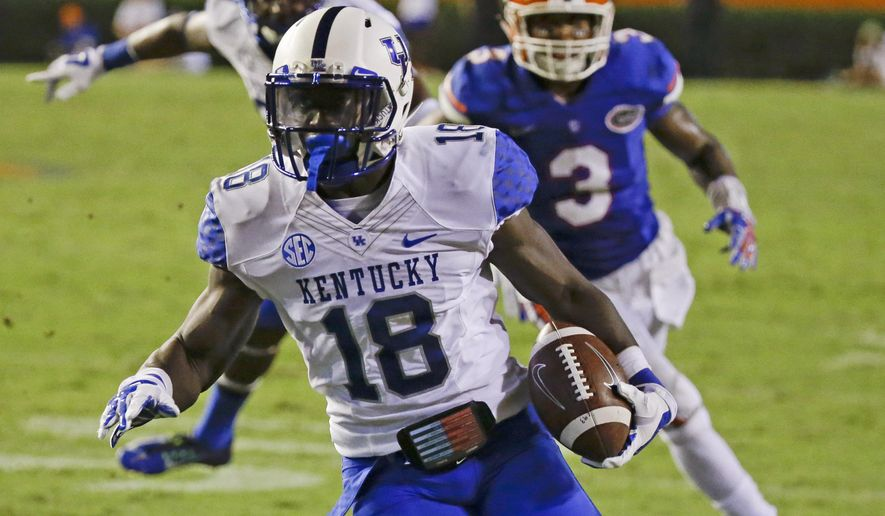 Kentucky running back Stanley Williams (18) runs past Florida linebacker Antonio Morrison (3) for a 25-yard touchdown on a reception during overtime of an NCAA college football game in Gainesville, Fla., Saturday, Sept. 13, 2014. Florida won in three overtimes, 36-30.(AP Photo/John Raoux)