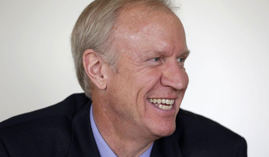 Illinois Republican gubernatorial candidate Bruce Rauner speaks during an interview in Chicago on Thursday, Sept. 18, 2014. Rauner is running against Democratic Gov. Pat Quinn in the November 2014 general election. (AP Photo/M. Spencer Green)