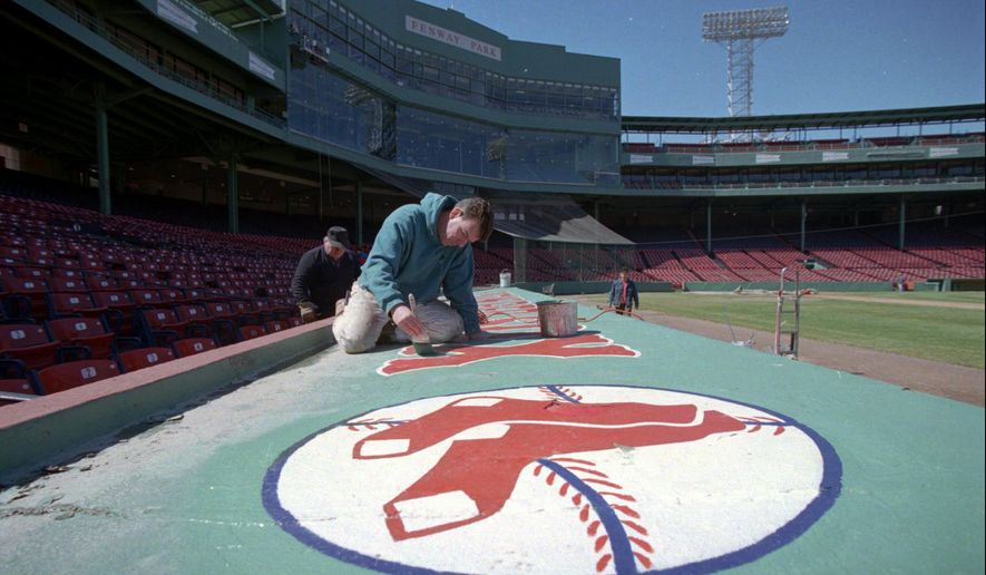 """FILE - In this April 3, 1996, file photo, John Flaherty, of South Boston, touches up the roof of a dugout at Boston's Fenway Park. The Red Sox are turning Fenway Park over to the Commonwealth Shakespeare Company on Friday night, Sept. 19, 2014, when the troupe performs a sort of best of bill, featuring 10 classic scenes in the ballpark that has always been more Big Papi than Joseph Papp, more Green Monster than """"green-ey'd monster,"""" more Carl Yastrzemski than Henry VIII. (AP Photo/Dan Loh)"""