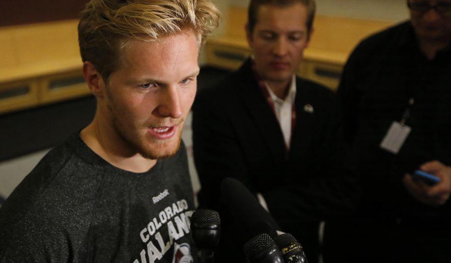 Colorado Avalanche's Gabriel Landeskog talks to the media during NHL hockey media day Thursday, Sept. 18, 2014, in Denver. (AP Photo/Jack Dempsey)