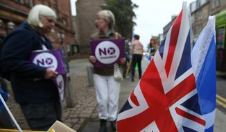 Scotland's voters arrive at polling places in Edinburgh on Thursday to decide whether or not the country will terminate its 307-year-old union with England and become a newly independent state.