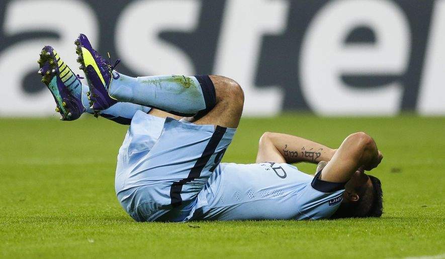 Manchester City's Sergio Aguero reacts during the Champions League Group E soccer match between FC Bayern Munich and Manchester City at Allianz Arena in Munich, southern Germany, Wednesday Sept. 17, 2014. (AP Photo/Matthias Schrader)
