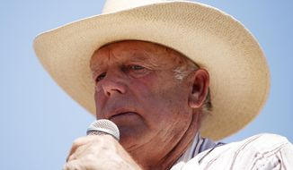 FILE - In this April 24, 2014, file photo, rancher Cliven Bundy speaks at a news conference near Bunkerville, Nev. A Las Vegas schoolteacher is suing Bundy, blaming him for her injuries and damage to her car in a crash with a Bundy cow on Interstate 15 near Mesquite. (AP Photo/Las Vegas Review-Journal, John Locher, File)