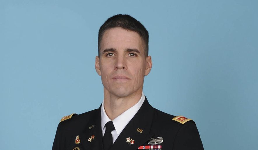 This undated photo provided by the U.S. Army shows Army Airborne Corps paratrooper Maj. Michael J. Donahue, 41, who was killed in action in Afghanistan on Tuesday, Sept. 16, 2014. Military officials said Wednesday that Donahue, of Columbus, Ohio, and 39-year-old Stephen Byus, of Reynoldsburg, Ohio, died on Tuesday in Kabul of wounds suffered from an enemy attack. (AP Photo/U.S. Army)