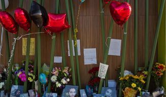 A memorial for Darrien Hunt is set up at the Panda Express in Saratoga Springs, Utah on Monday, Sept. 15, 2014. Hunt was shot by police outside the restaurant on Sept. 10. (AP Photo/The Daily Herald, Spenser Heaps)